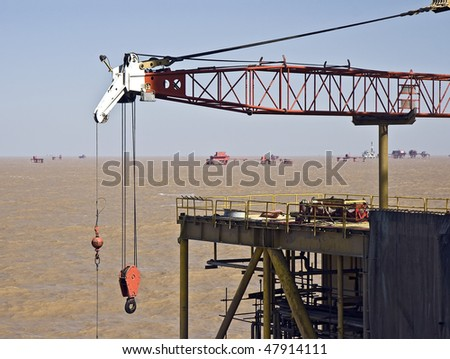Offshore oil field at the mouth of the Yellow River in the Bohai Sea, northern China. View taken from a nearby drilling platform - stock photo