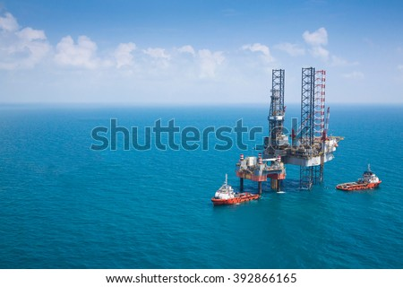 Offshore oil rig drilling platform with copy space. - stock photo