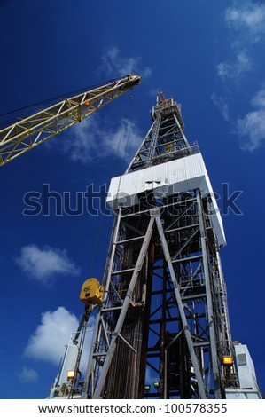 Offshore Oil Rig (Jack Up Rig) and Rig Crane with Blue Sky - stock photo