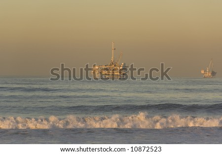 Offshore Oil Rigs taken from Huntington Beach California at Dawn - stock photo