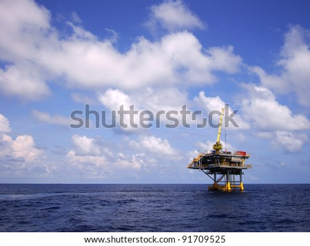 Offshore Production Platform in the Middle of Sea for Oil and Gas Production - stock photo
