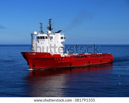 Offshore Supply Ship underway at sea to offshore platform. - stock photo