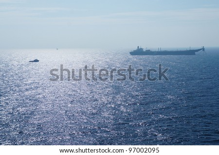 Offshore Tanker and Crew Boat in The Middle of The Sea - stock photo