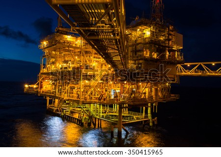 Offshore the night Industry oil and gas production petroleum pipeline. - stock photo