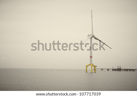 Offshore wind turbine for generating renewable and sustainable electric power from natural wind energy - stock photo