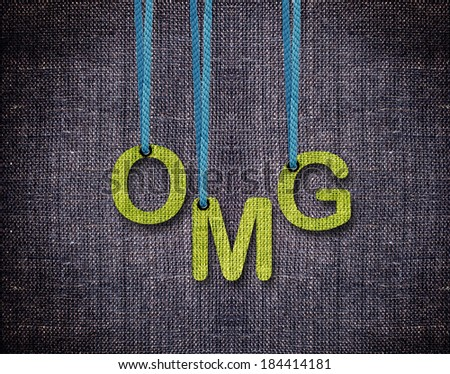 Oh my Gud, OMG Letters hanging strings with blue sackcloth background. - stock photo