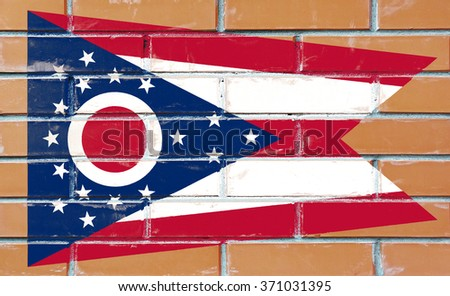 Ohio state flag of America on brick wall - stock photo