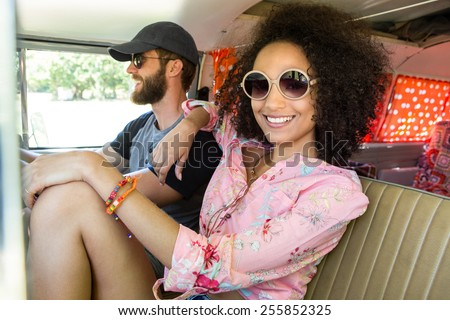 oHipster couple driving in camper van n a summers day - stock photo