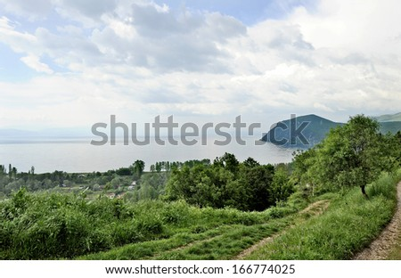 OHRID, MACEDONIA, MAY 18, 2011. A view to lake Ohrid. Forest in the front. - stock photo