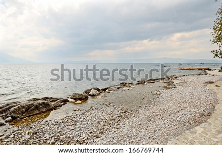 OHRID, MACEDONIA, MAY 18, 2011. Rocks and rocky sand in the shoreline of lake Ohrid.