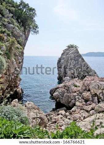 OHRID, MACEDONIA, MAY 18, 2011. Rocks in the shore of lake ohrid. - stock photo
