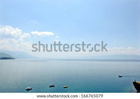 OHRID, MACEDONIA, MAY 18, 2011. Small boats in lake Ohrid. - stock photo