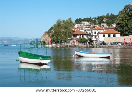 Ohrid village and row boat on the lake, Republic of Macedonia - stock photo