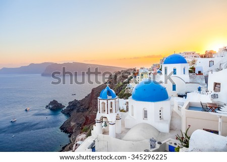 Oia at sunset, Santorini island, Greece - stock photo