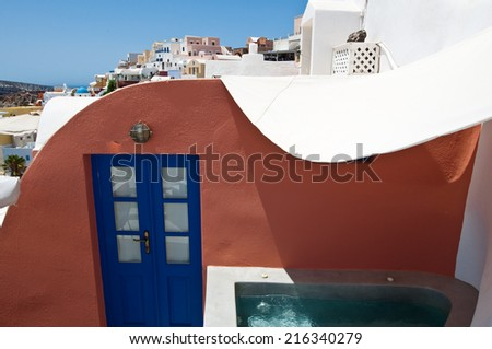 Oia cave houses on the lip of the volcanic crater on the island of Thera (Santorini), Greece. - stock photo