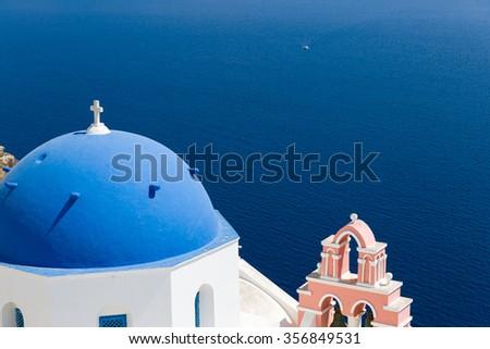 Oia church with cupola painted blue, Santorini Greece - stock photo