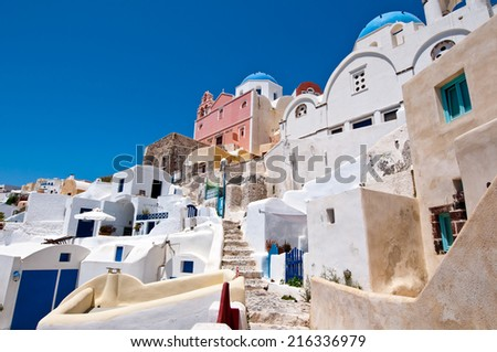 Oia cityscape with cave houses on the island of Thera (Santorini), Greece. - stock photo