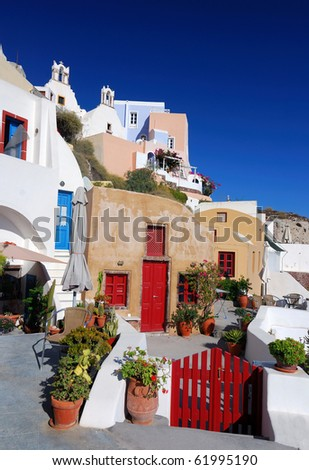 Oia is a community on the islands of Thira (Santorini) and Therasia, in the Cyclades, Greece. - stock photo