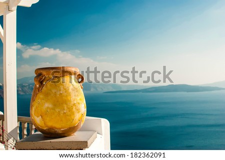 Oia Santorini Greece famous with romantic and beautiful sunsets - stock photo