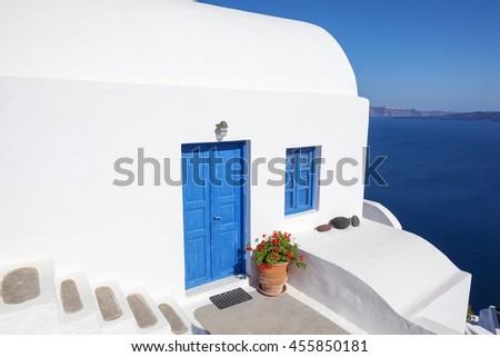 Oia, typical town of Santorini, Greece. - stock photo
