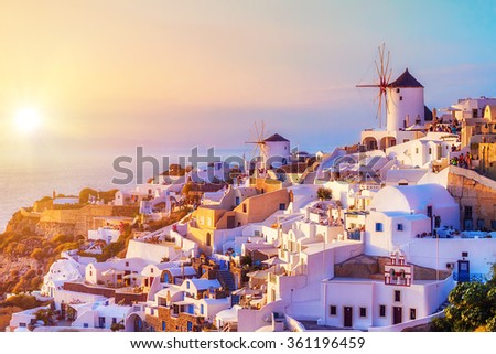 Oia village at sunset, Santorini island, Greece - stock photo