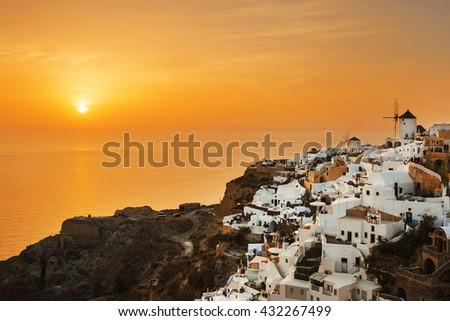 Oia village at sunset, Santorini island, Greece - stock photo