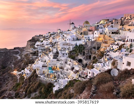 Oia Village in Cycladic Architecture style in Santorini, Greece during a pink sunset.