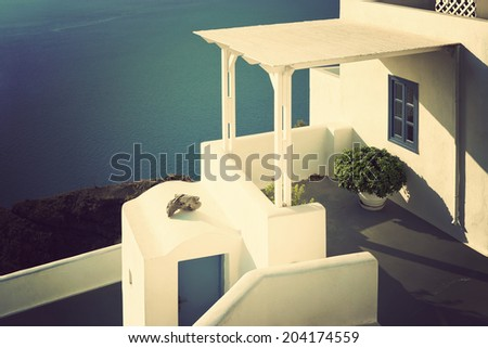 Oia village in Santorini island in Greece. (View of the sea and the village). Vintage style.