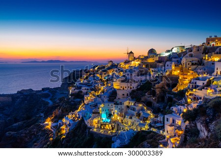 Oia village lights at night with dusk sky colors, Santorini, Cyclades, Greece - stock photo