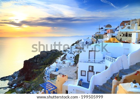 Oia village with traditional buildings at sunset, Santorini island, Greece - stock photo