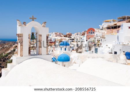 Oia village with typical houses on the island of Santorini,Greece. - stock photo