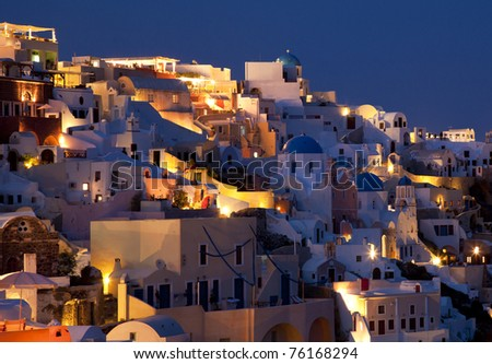 Oia white wash building at dusk in santorini island Greece