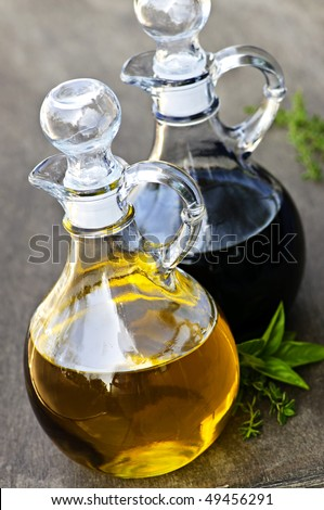 Oil and balsamic vinegar glass bottles with spouts - stock photo