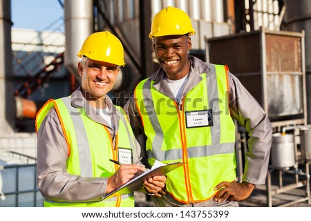 oil and chemical co-workers in refinery plant - stock photo