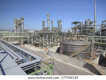 Oil and chemical plant with blue sky - stock photo