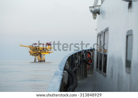 Oil and gas construction in the sea and view from supply boat, Production platform in oil and gas industry, Oil and gas business. - stock photo