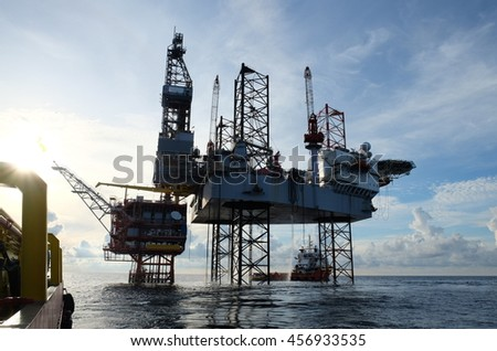 Oil and gas construction in the sea and view from supply boat, Production platform in oil and gas industry, Oil and gas business.