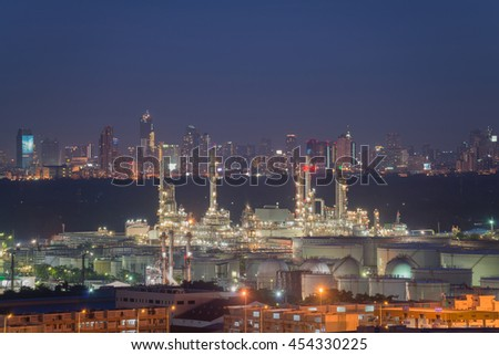 Oil and gas industry; Oil refinery factory at sunset. Petrochemical industrial.