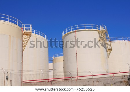 Oil and gas industry. Oil reservoirs on a petrochemical plant - stock photo