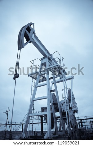 Oil and gas industry. Pump jack. Monochrome. - stock photo