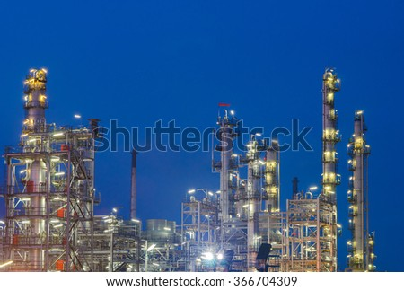 Oil and gas industry - refinery at night - factory - petrochemical plant - stock photo
