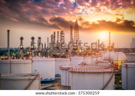 Oil and gas industry - refinery at sunset - factory - petrochemecal plant - stock photo