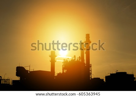 Oil and gas industry,refinery,petrochemical plant with silhouette sunset.