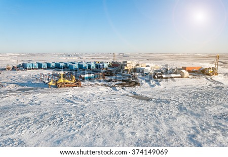 Oil and gas industry. Winter industrial landscape. Construction site in wild place in the North. - stock photo
