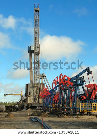 Oil and gas industry. Work of oil pump jack on a oil field. Borehole - stock photo