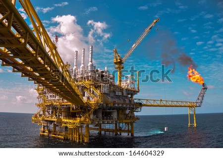 Oil and gas platform with gas burning, Power energy. - stock photo