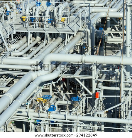 Oil and gas processing plant with pipe line valves - stock photo