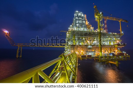 Oil and gas processing platform producing oil gas and water sent to onshore refinery and power generation plant - stock photo