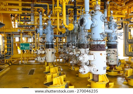 Oil and gas production slot on the platform, Well head control on oil and rig industry, Heavy industry in offshore oil and gas business. - stock photo