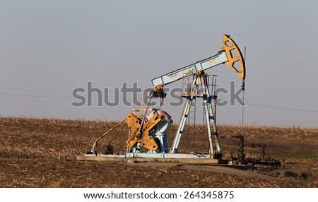 Oil and gas pump operating in agricultural area in Europe